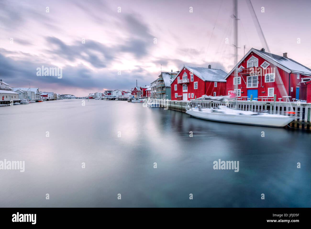 The typical fishing village of Henningsvaer with its red houses called rorbu Lofoten Islands Northern Norway Europe - Stock Image