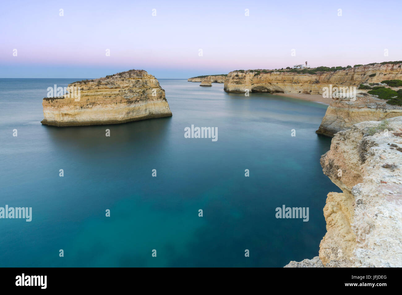 Top View of cliffs and turquoise water of Praia De Albandeira Carvoeiro Caramujeira Lagoa Municipality Algarve Portugal Stock Photo