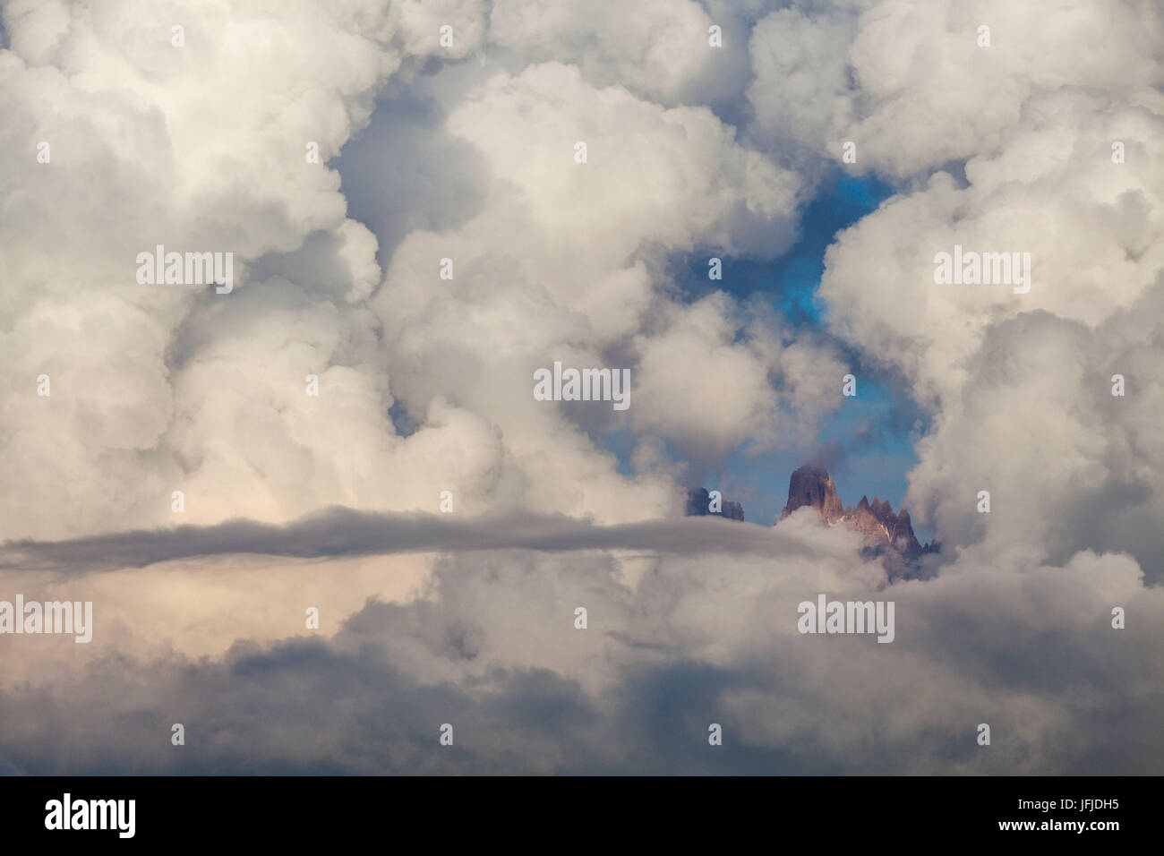 Brenta dolomites, Trentino Alto Adige, Italy, The Torre of Brenta emerges from the clouds - Stock Image