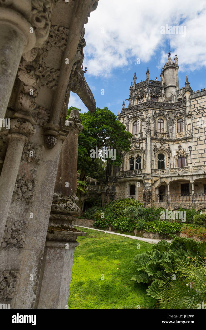 Old mystical buildings of Romanesque Gothic and Renaissance style inside the park Quinta da Regaleira Sintra Portugal - Stock Image