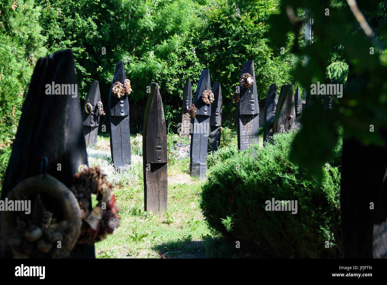 Szatmarczeke , Hungary. Wooden boat shaped gravestones on the cemetery - Stock Image