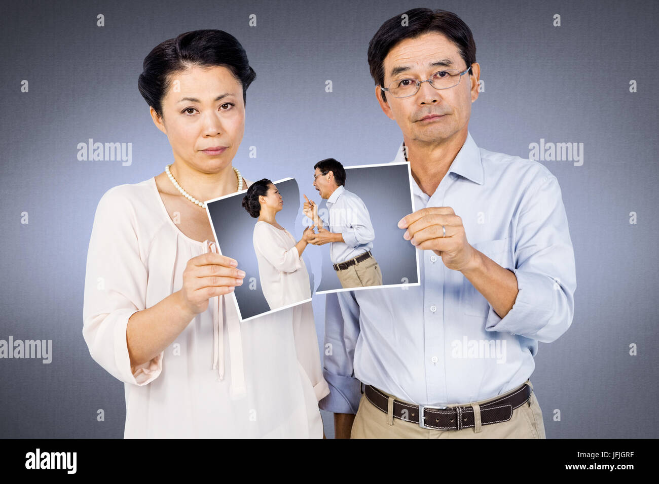 Composite image of asian couple holding a photo Stock Photo