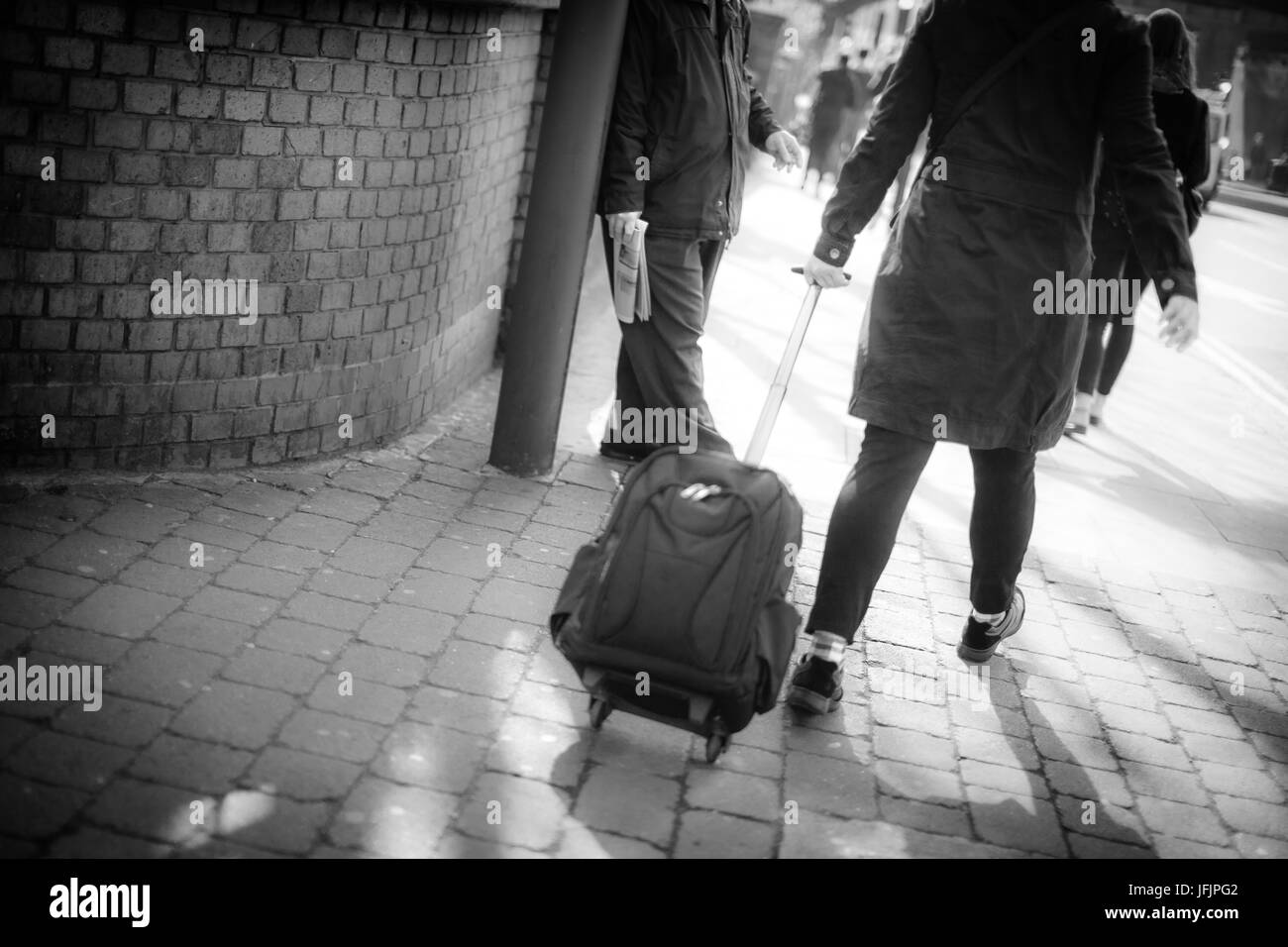 Rushing to the train station - Stock Image