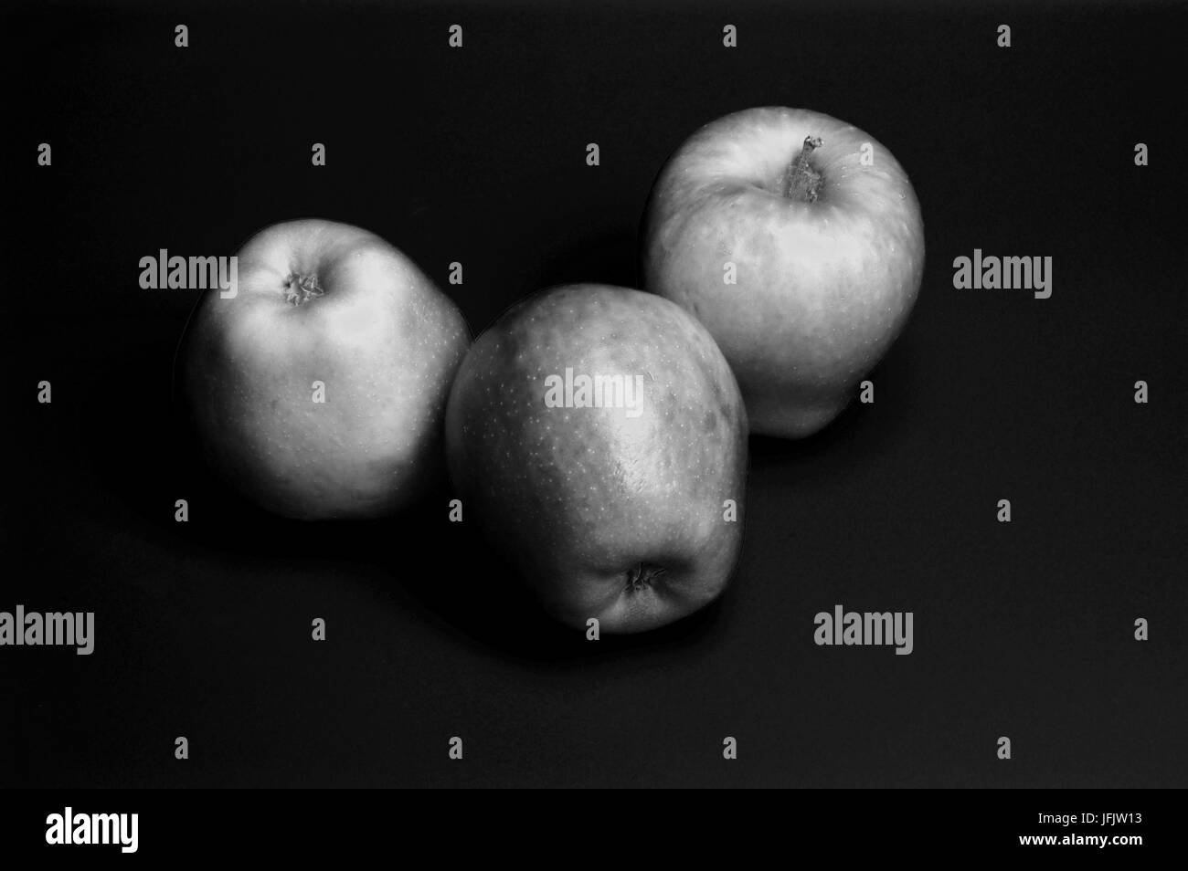 three apples in black and white, fruot - Stock Image