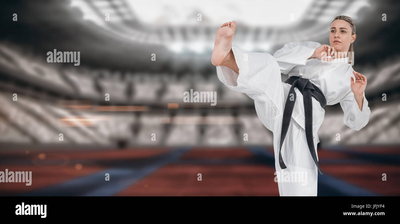 Composite image of female athlete practicing judo - Stock Image