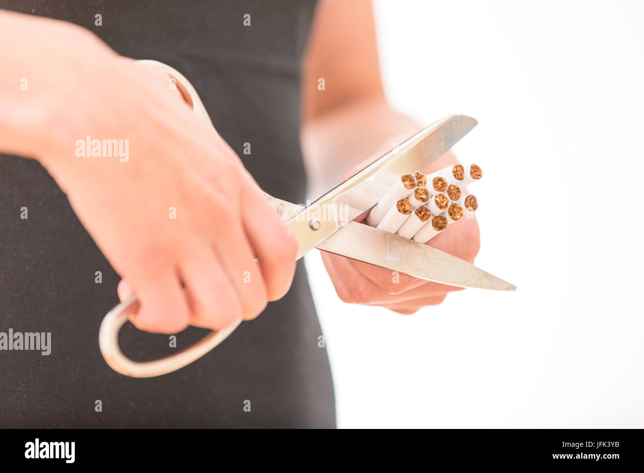 Quit Smoking. Closeup Of Woman Hands Cutting Cigarettes - Stock Image