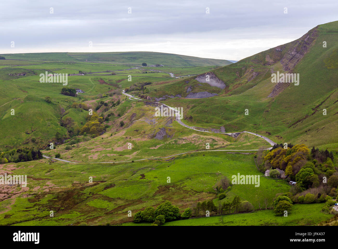 The former A625 crossed the landslips below Mam Tor in Castleton, Derbyshire but was finally abandoned in 1979 due - Stock Image