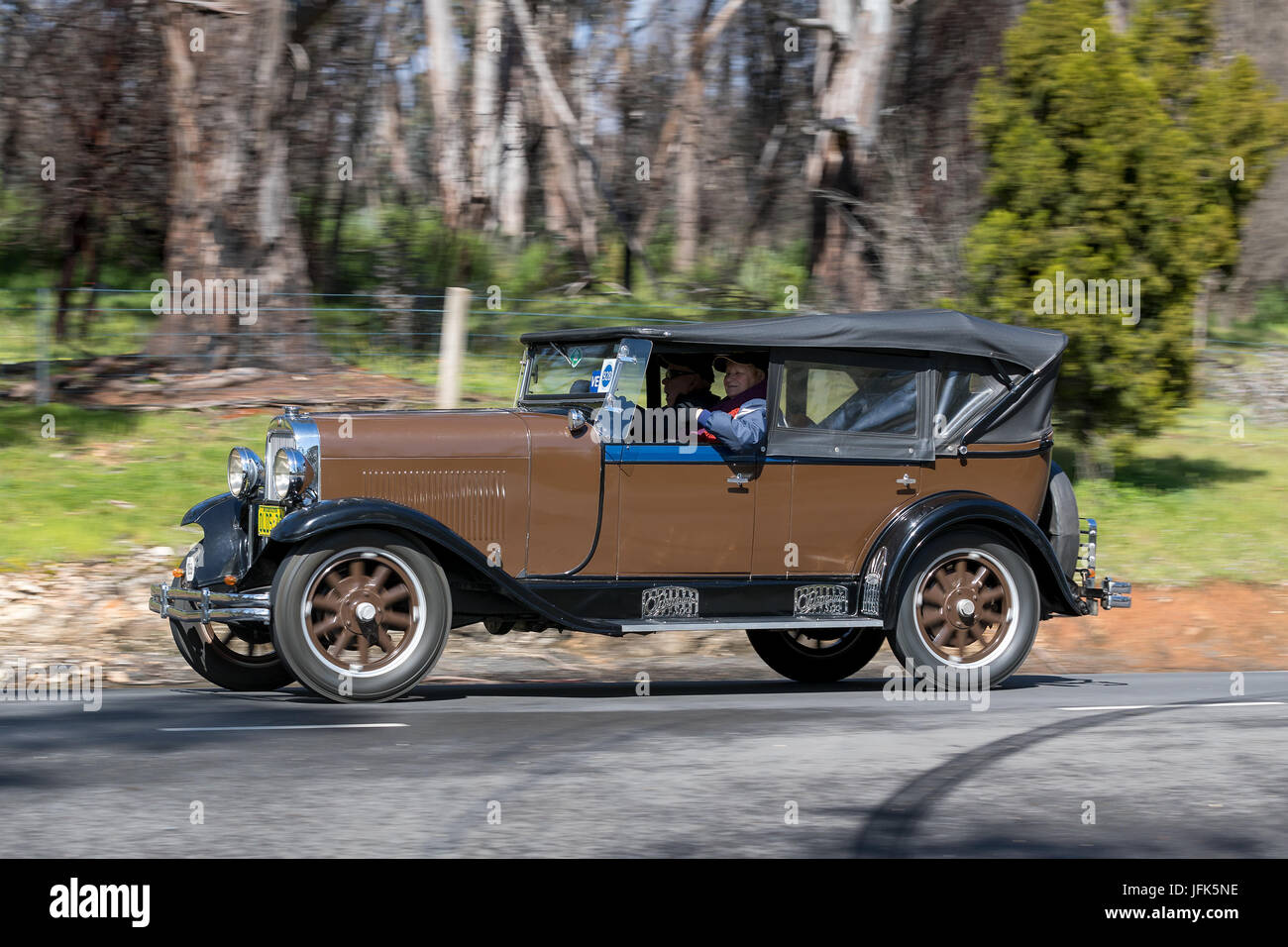 Vintage 1929 Oldsmobile FR Tourer driving on country roads near the town of Birdwood, South Australia. - Stock Image
