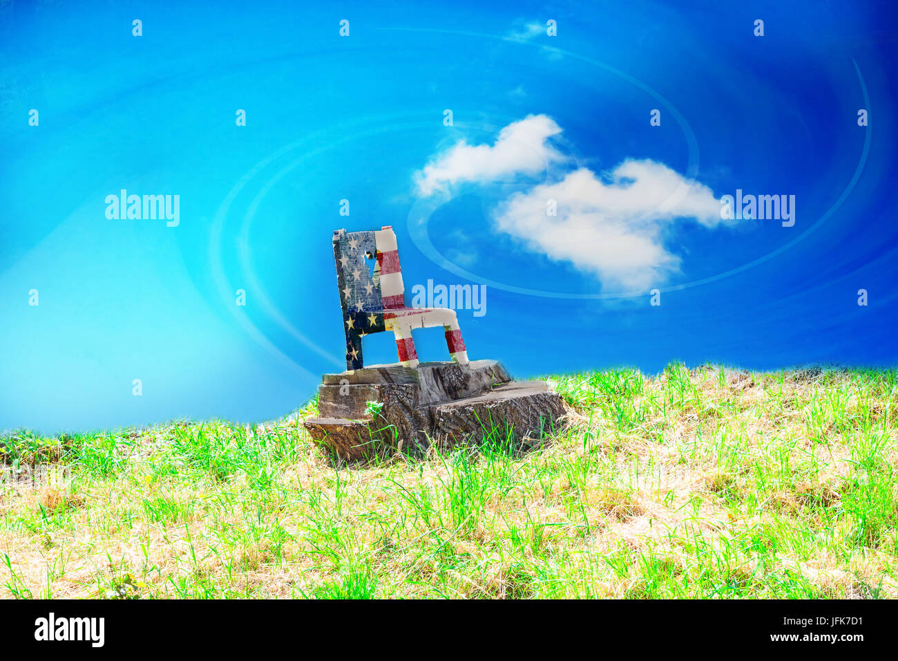 Wooden chair on a lawn in Stars and Stripes colors - Stock Image