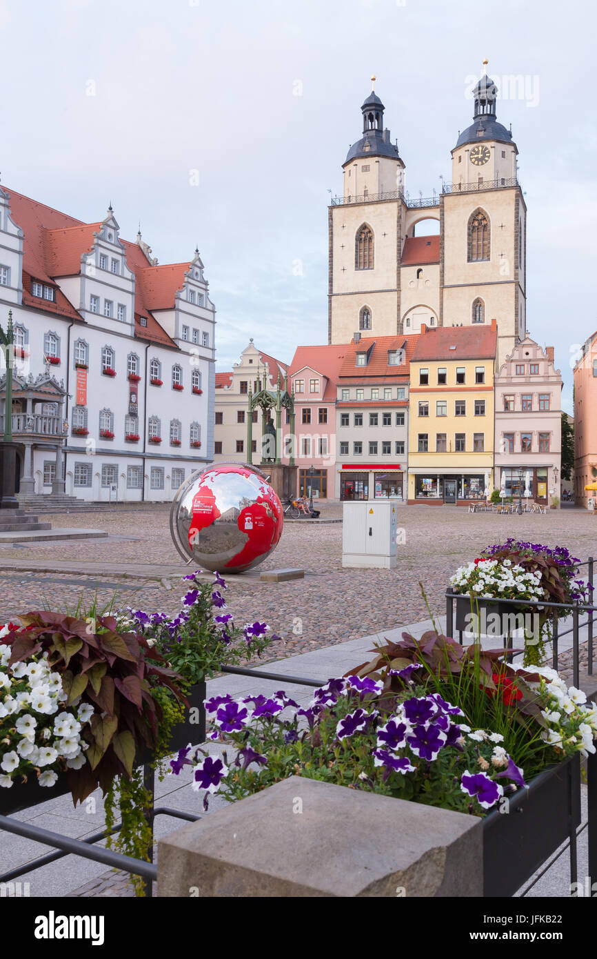 Earth globe on the town hall square - Stock Image