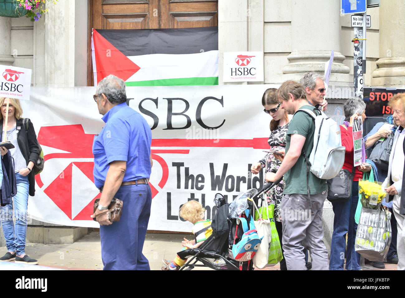 Protesters outside HSBC bank in protesting against arming Israel in Brighton, East Sussex, England, UK. - Stock Image