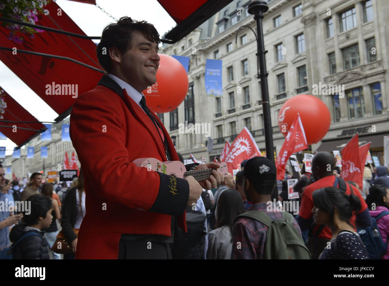London, UK, 1st July 2017, Not one day more march, the demonstration passes Hamleys store. Martin Kelly/Alamy Live - Stock Image