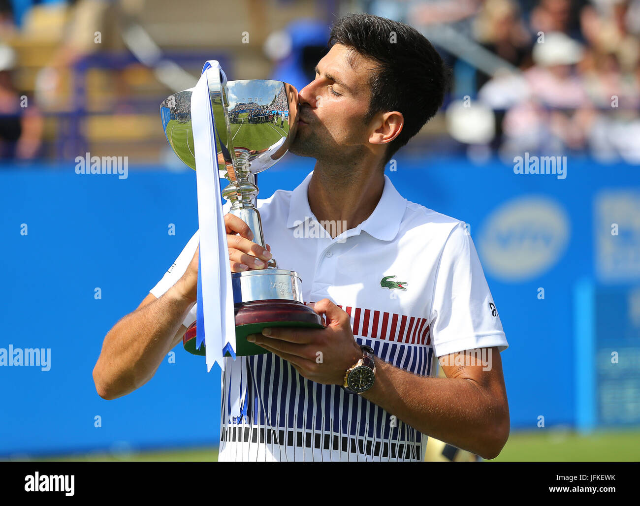 Eastbourne, UK 01st July, 2017 Novak Djokovic of Serbia celebrates with his trophy after beating Gael Monfils of - Stock Image