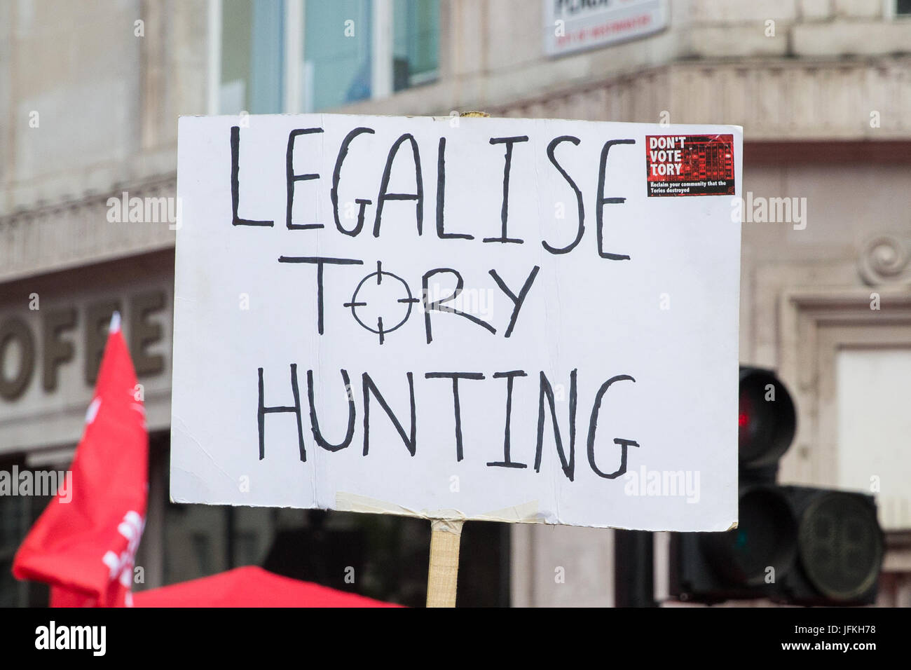 London, UK. 1st July, 2017. A protester holds a sign reading 'Legalise Tory Hunting' at the Not One More - Stock Image
