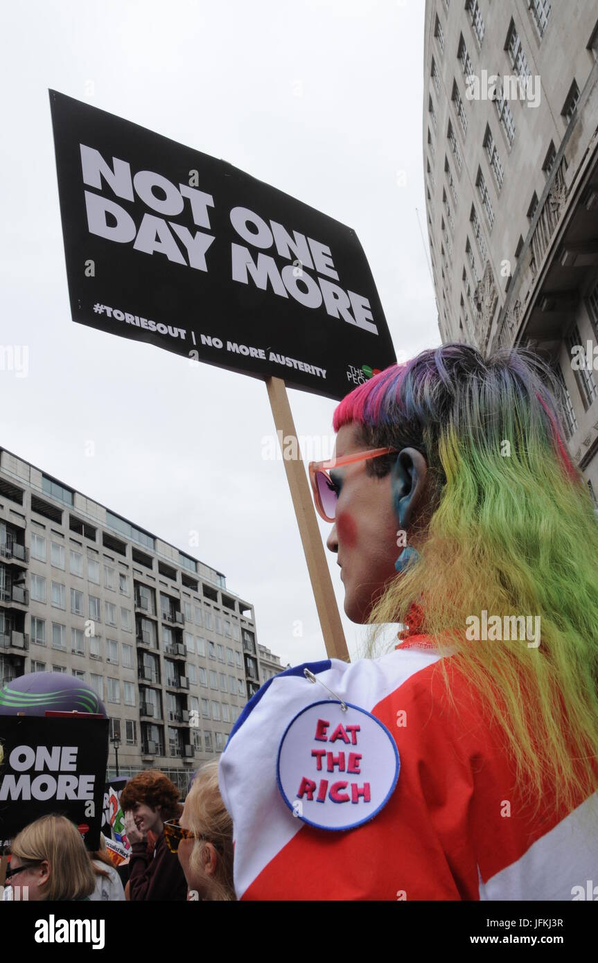 A member of the LGBT community attends John McDonnell's Anti-Tory March in London. - Stock Image