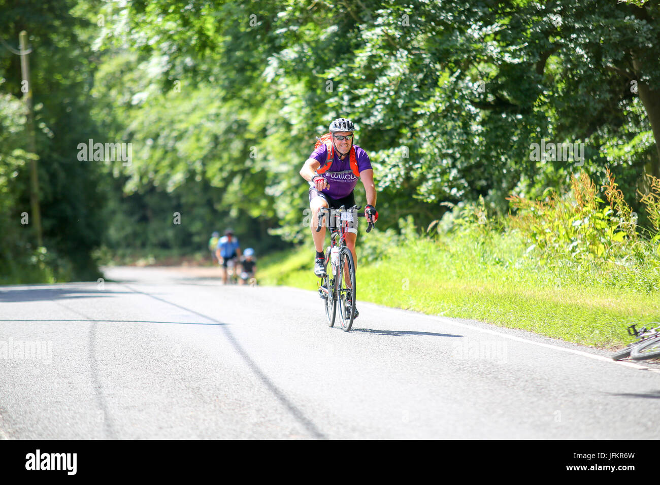 Elmdon, Essex. UK. 2nd July, 2017. Cyclists on the London to Cambridge cycle ride pass through the Essex village Stock Photo