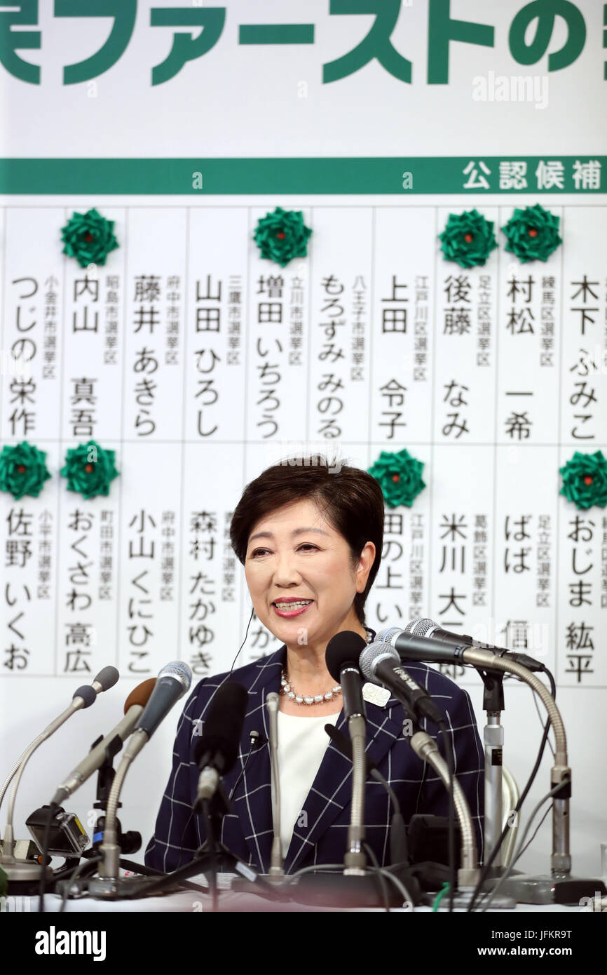 Tokyo, Japan. 2nd July, 2017. Tokyo Governor Yuriko Koike smiles as she puts a rosette on a candidate name of her - Stock Image