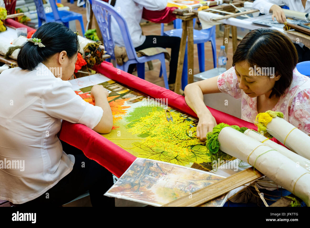 Vietnamese Art and Craft workers producing art works - Stock Image