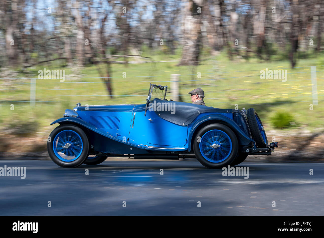 Vintage 1934 MG ND Roadster  driving on country roads near the town of Birdwood, South Australia. - Stock Image