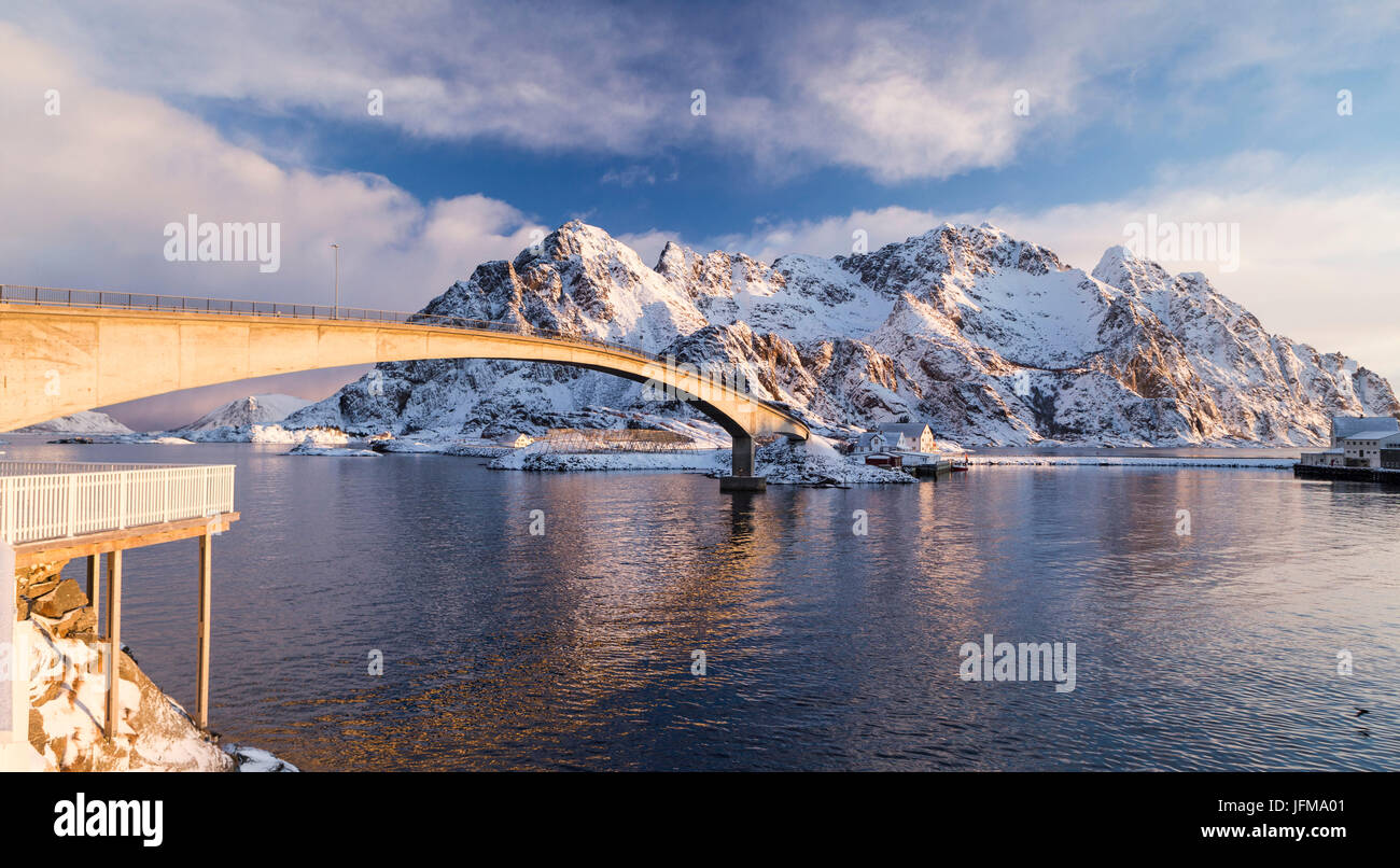 Bridge crossing to the mountains in the Fishing village of Henningsvær Fishing village, Lofoten Islands, Norway - Stock Image
