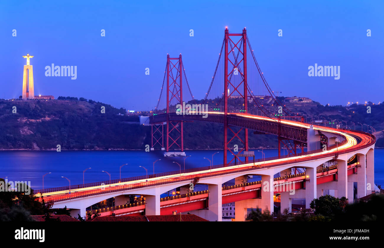 The 25 de Abril Bridge and Christ the King monument, Lisbon, Portugal Stock Photo