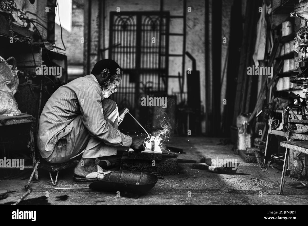 Asia, India, Varanasi district, Man at work - Stock Image
