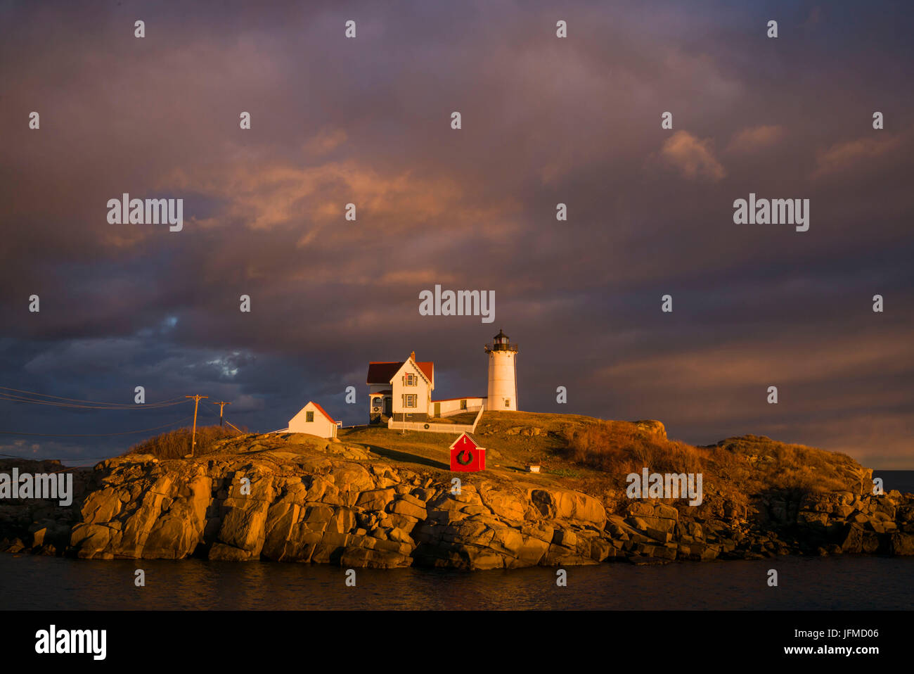 usa maine york beach nubble light lighthouse with christmas decorations sunset - Christmas Lighthouse Decorations