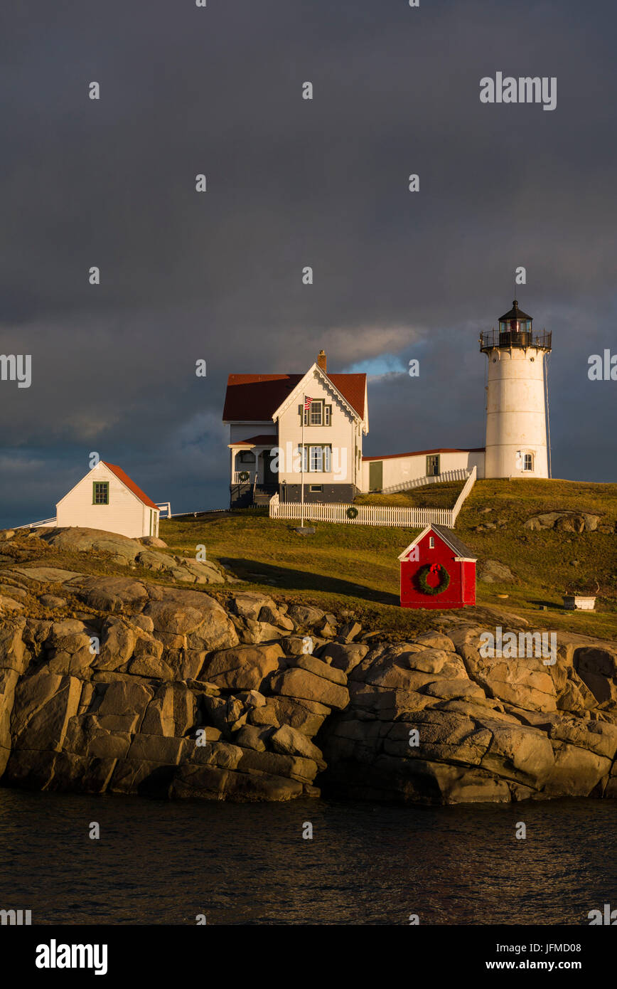 usa maine york beach nubble light lighthouse with christmas decorations sunset
