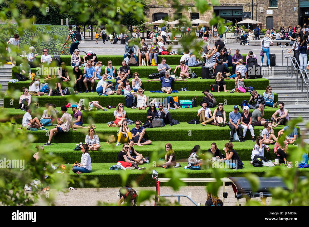 Granary Square at the heart of the regeneration of the King's Cross area along Regent's canal, London, England, - Stock Image