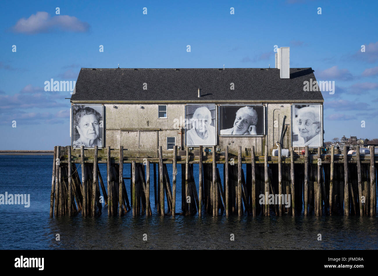 USA, Massachusetts, Cape Cod, Provincetown, Provincetown Pier, photos of fishermen's wives - Stock Image