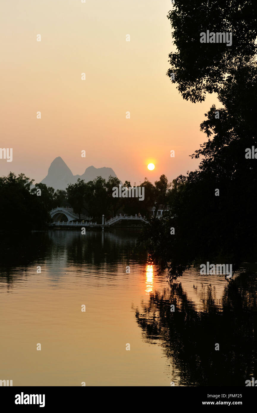 China, Guangxi Province, Guilin, Double Bridge on Rong Lake with Karst mountain landscape Stock Photo