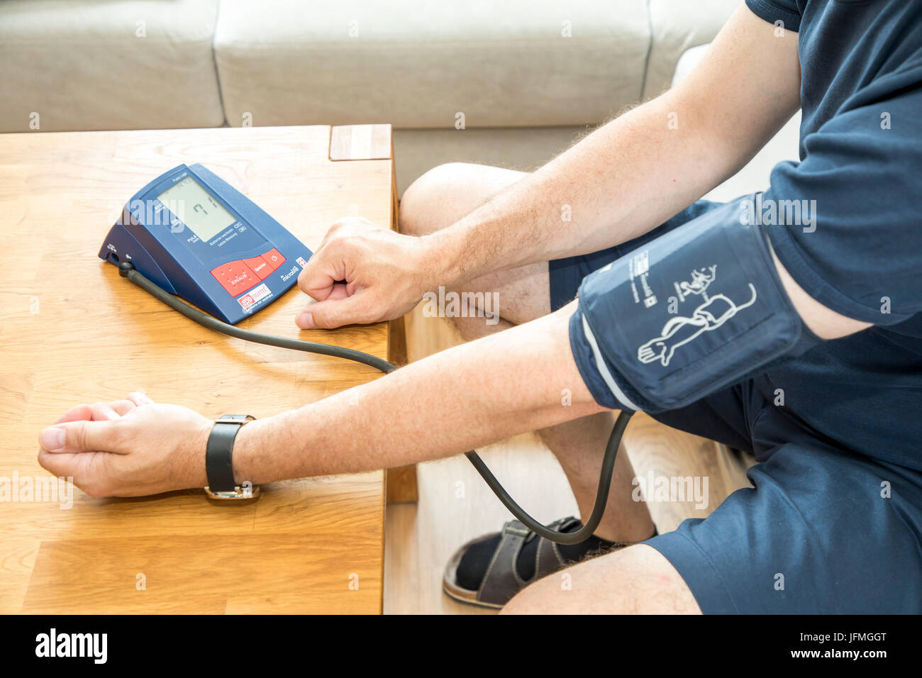 Blood pressure measurement, with an automatic upper arm blood pressure meter, - Stock Image