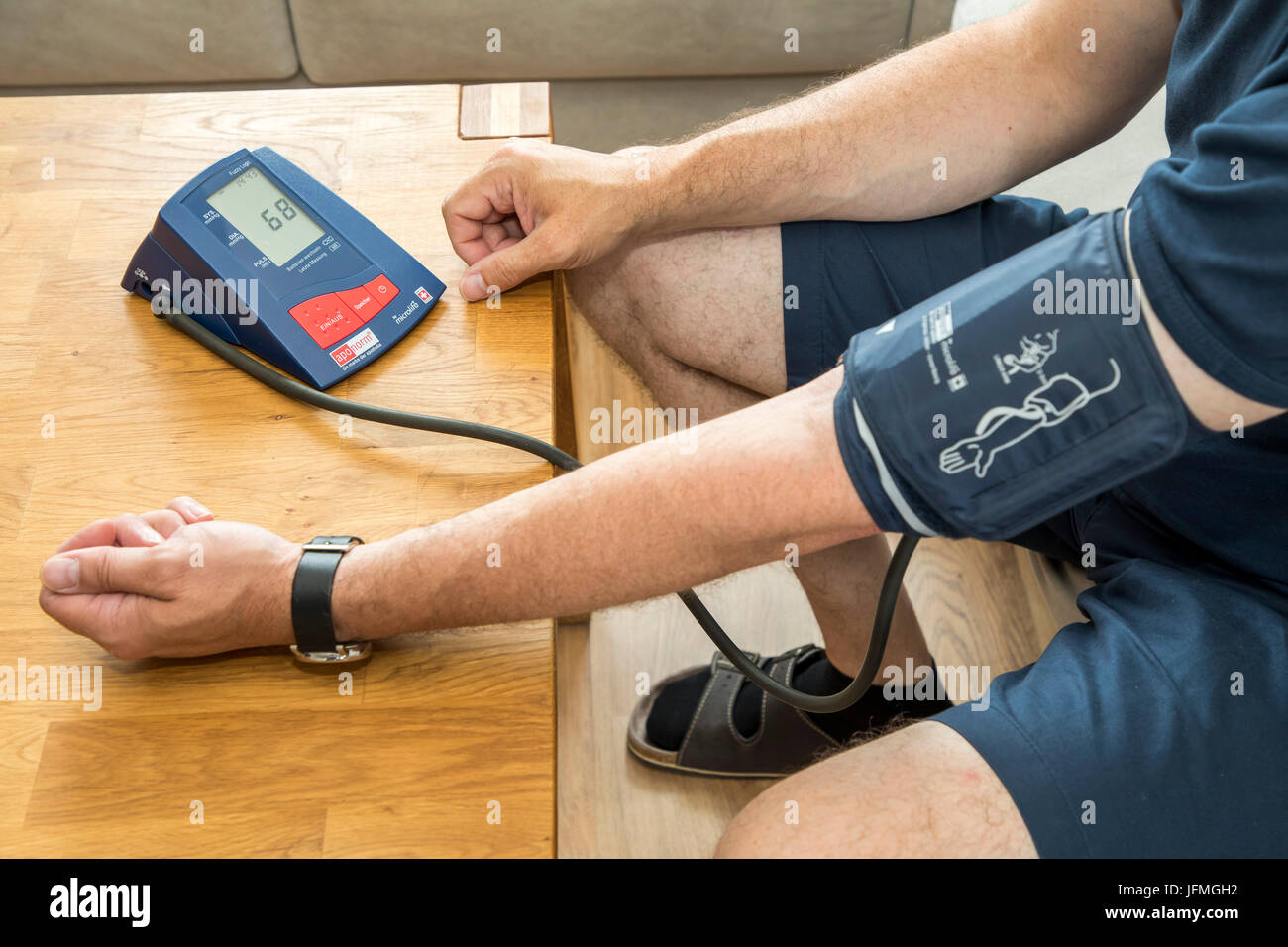 Blood pressure measurement, with an automatic upper arm blood pressure meter, Stock Photo