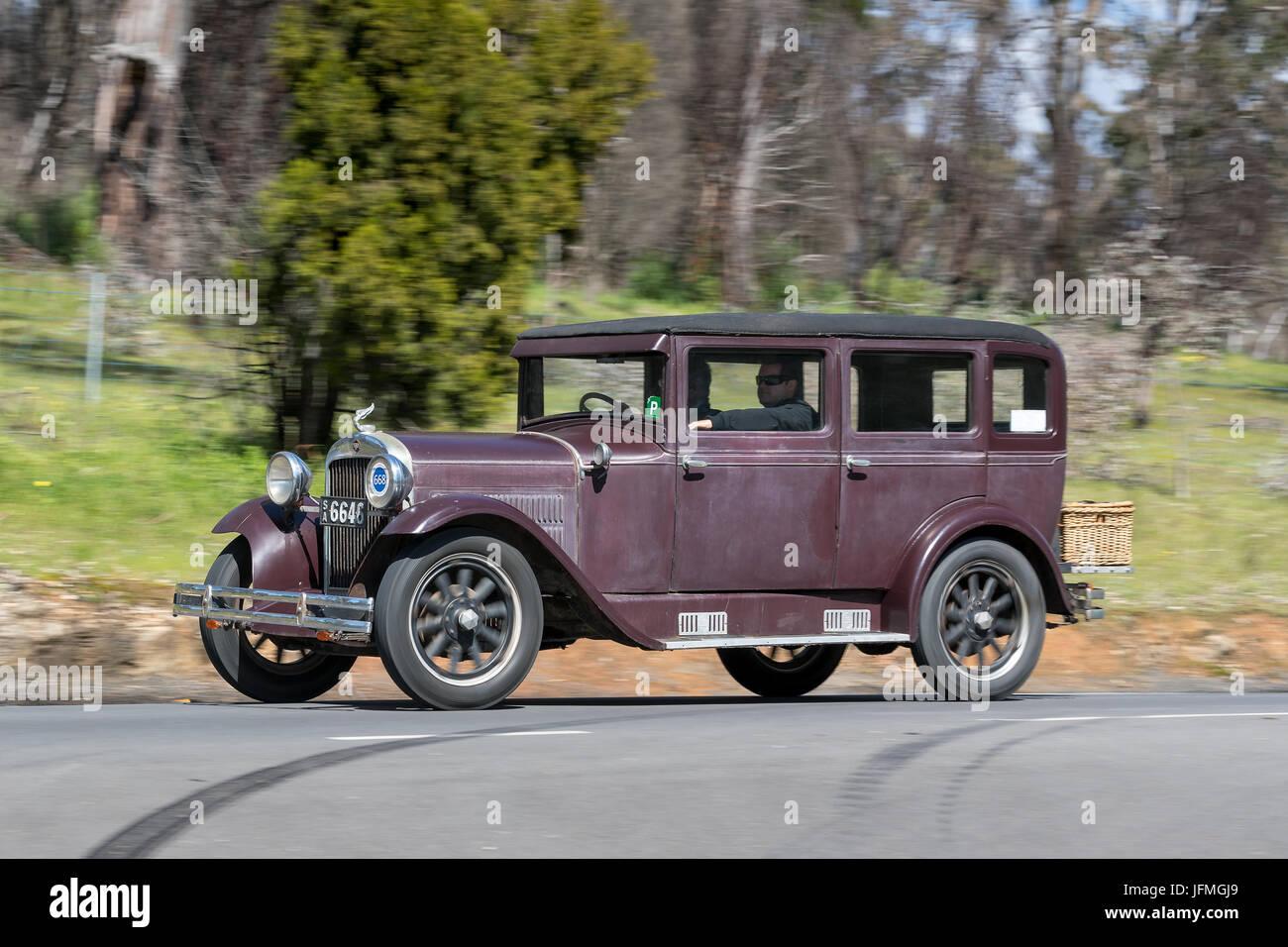 Vintage 1929 Essex Super Six Sedan driving on country roads