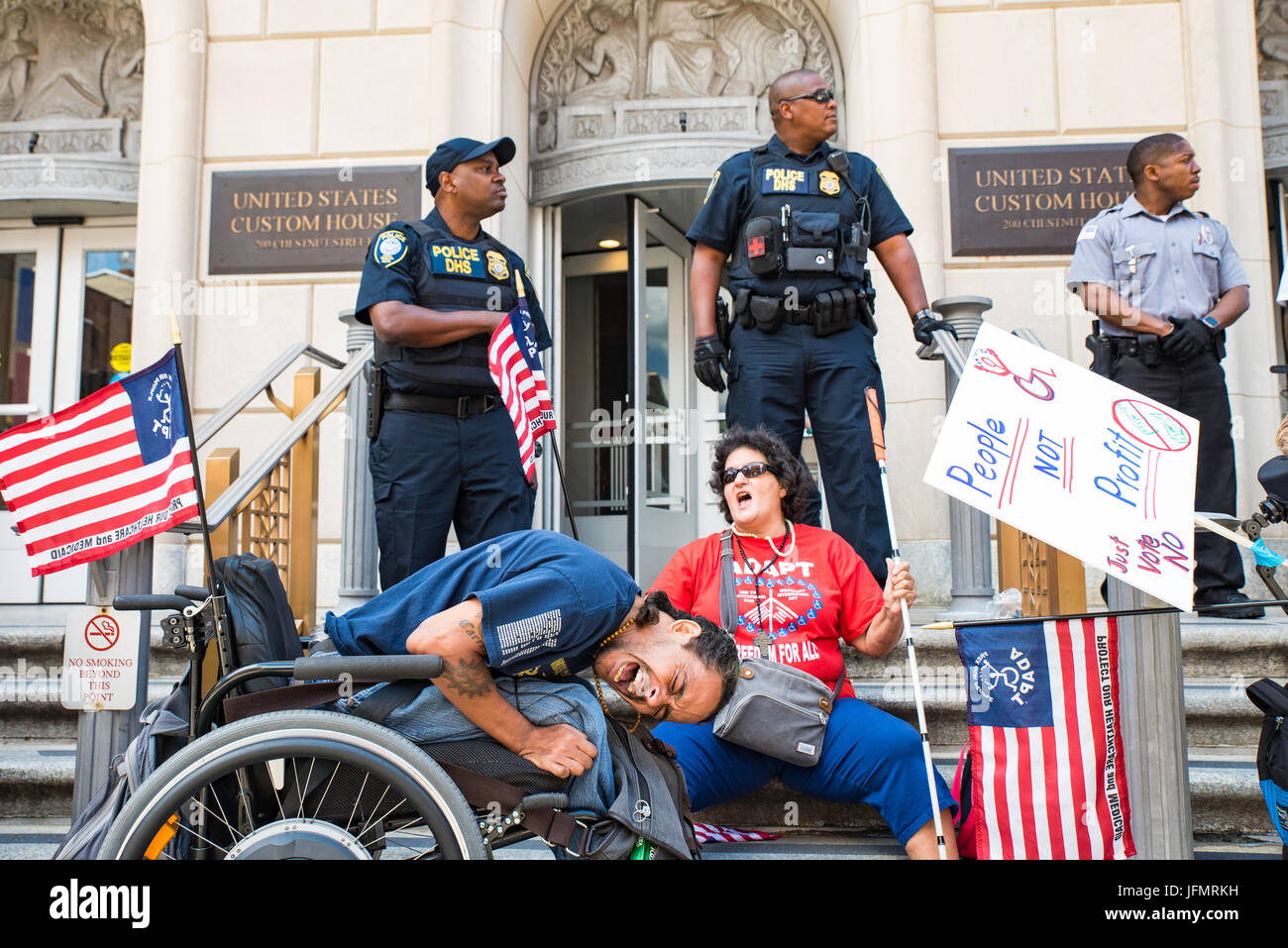 PA ADAPT member German Parodi blockades the entrance to the US Customs building where Senator Pat Toomey's office - Stock Image