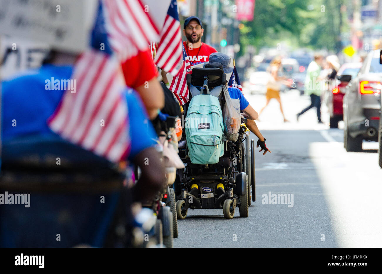 PA ADAPT members march in wheelchairs to the Philadelphia office of Republican Senator, Pat Toomey. - Stock Image