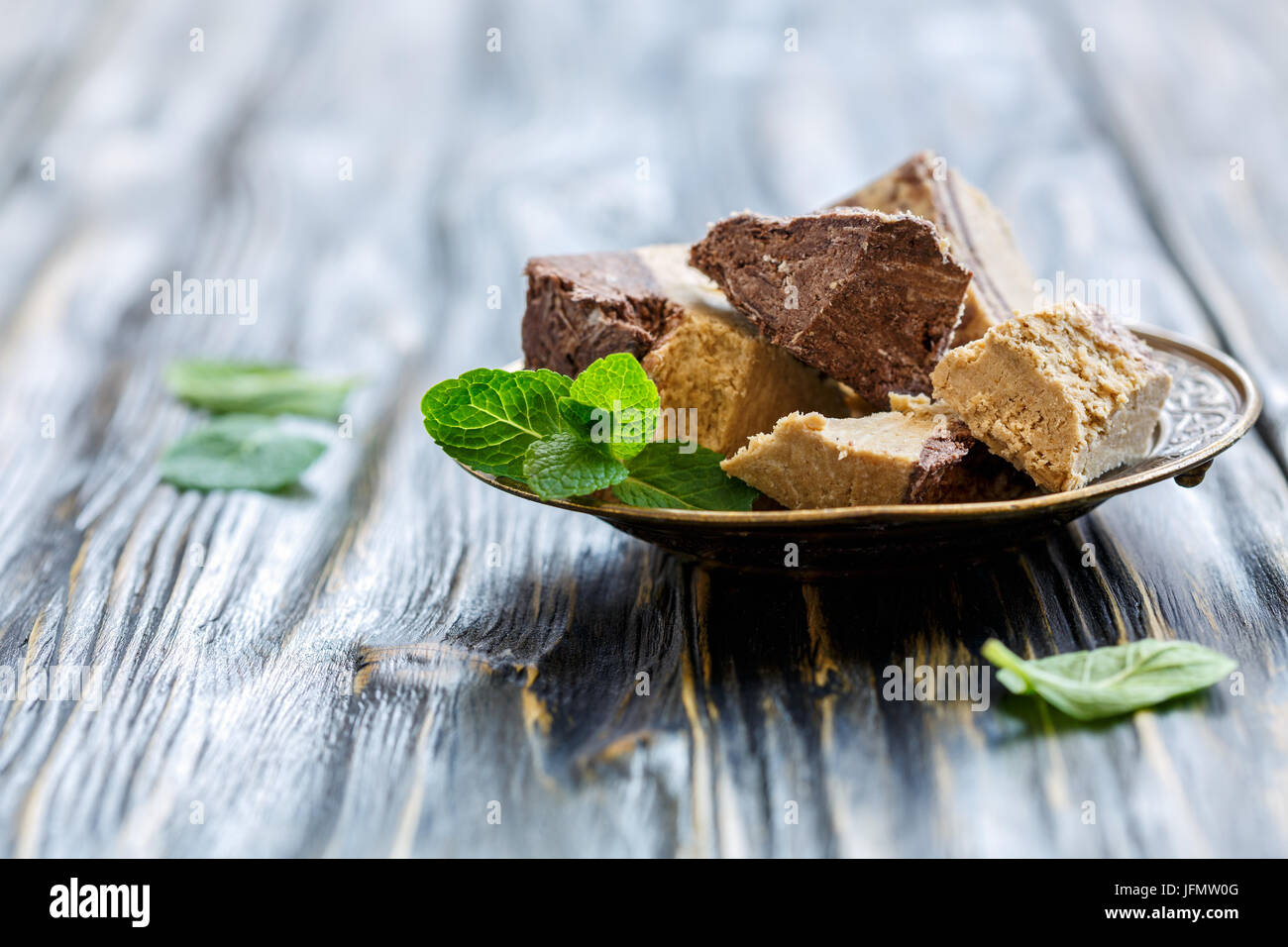 Plate of halva from sesame seeds with chocolate. - Stock Image