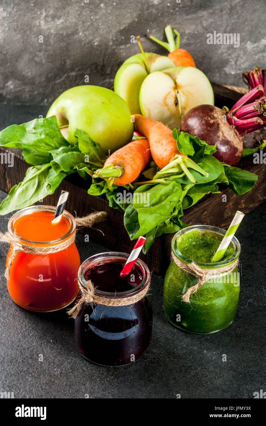 Vegan diet food. Detox drinks. Freshly squeezed juices and smoothies from vegetables: beets, carrots, spinach, cucumber, - Stock Image