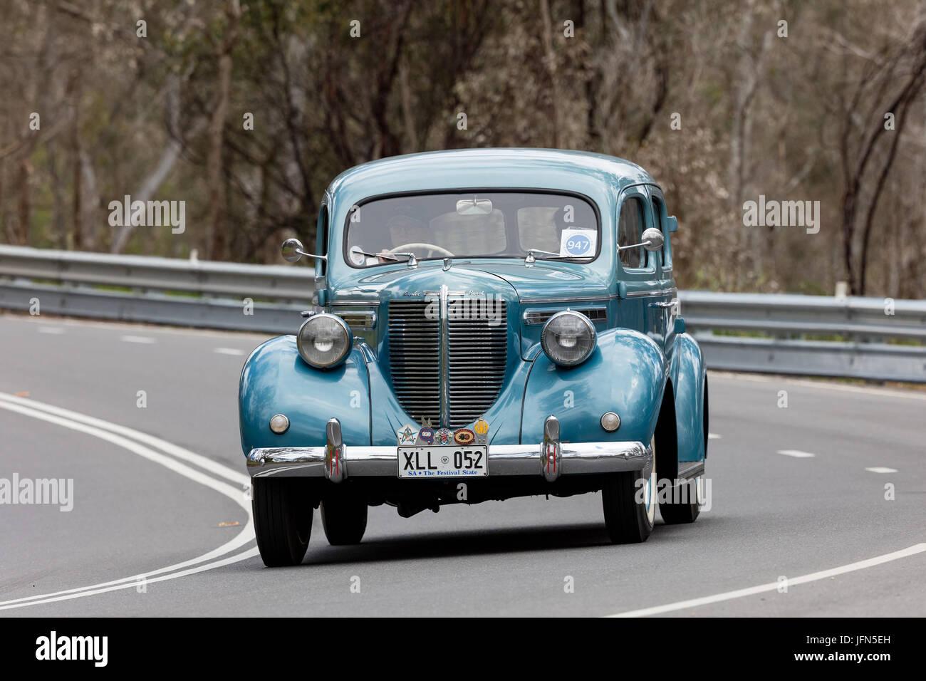 Vintage 1938 Chrysler C18 Royale Sedan driving on country roads near the town of Birdwood, South Australia. - Stock Image