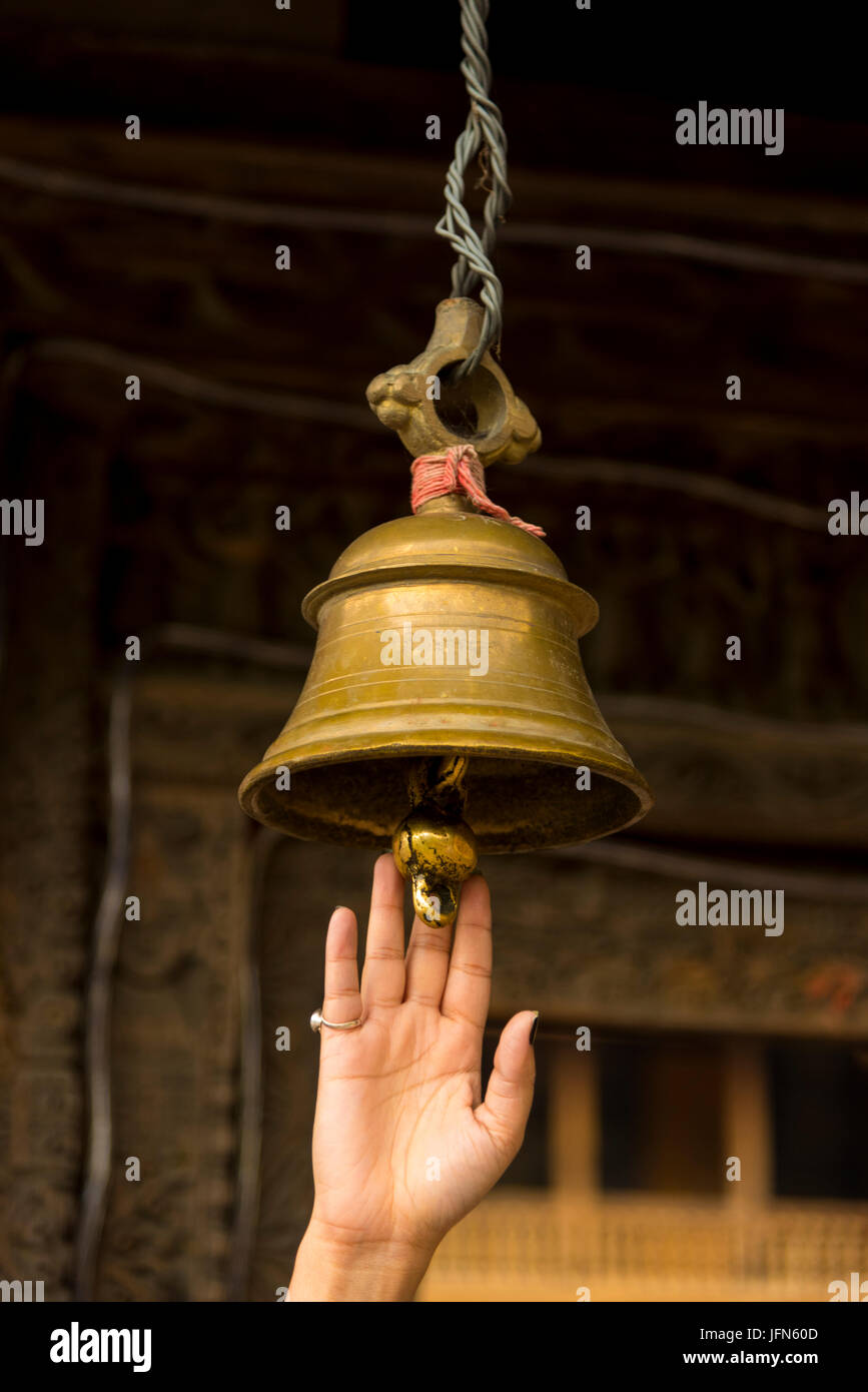 Temple Bell in Ancient Prashar Lake Temple view with Prashar Holy water Pond and Green nature landscape at Prashar - Stock Image