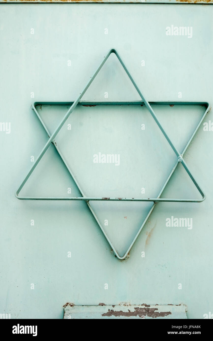 A cyan star of david made of metal attached to a local synagogue Stock Photo