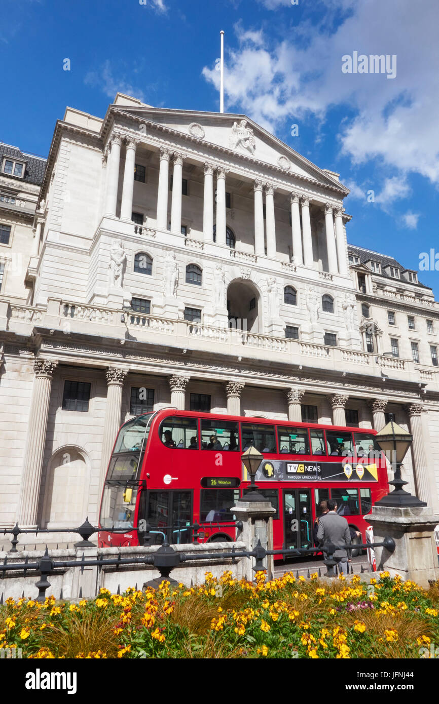 Red bus passing the Bank of England building, Threadneedle Street, City of London, EC1, England, United Kingdom, - Stock Image