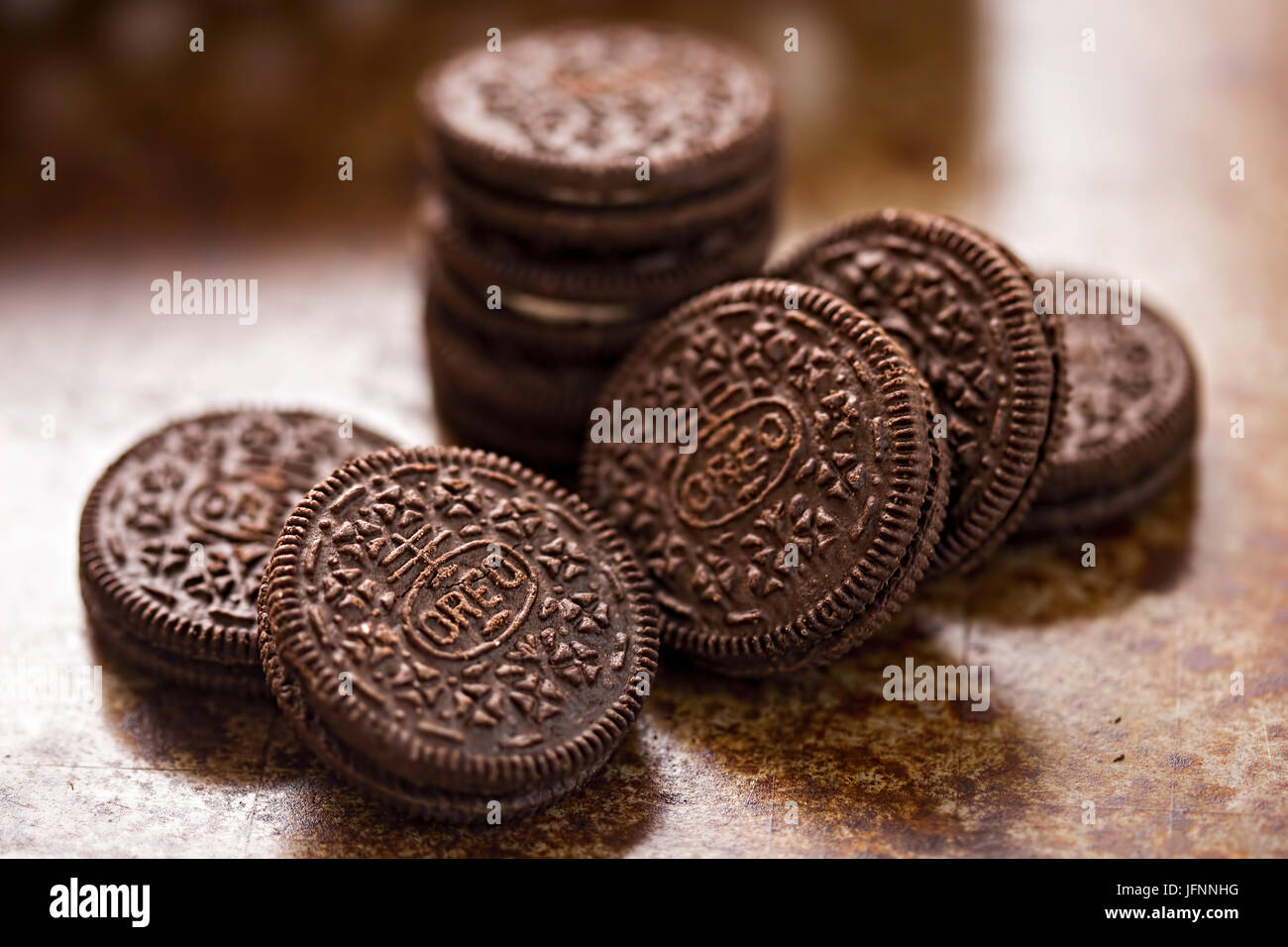 Oreo cookies on brown background - Stock Image