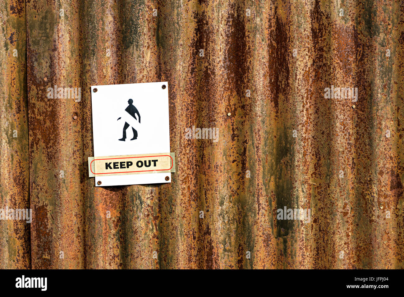Faded keep out sign on rusting metal, Llangollen, Denbighshire, Wales - Stock Image