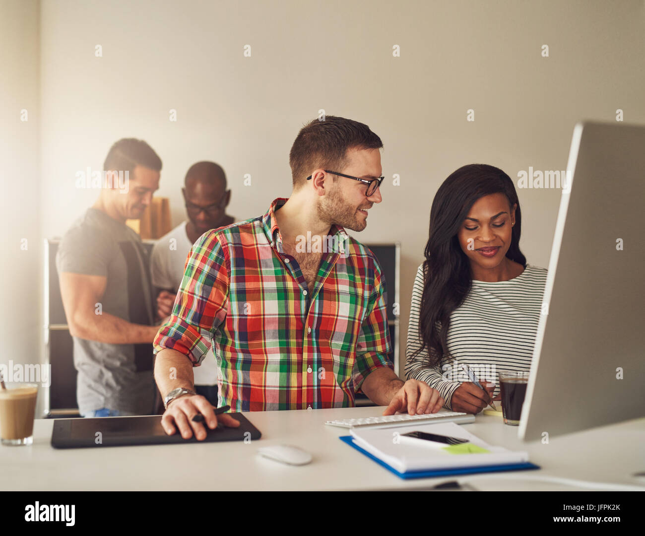 The office team at the computer writing the notes during the meeting. - Stock Image