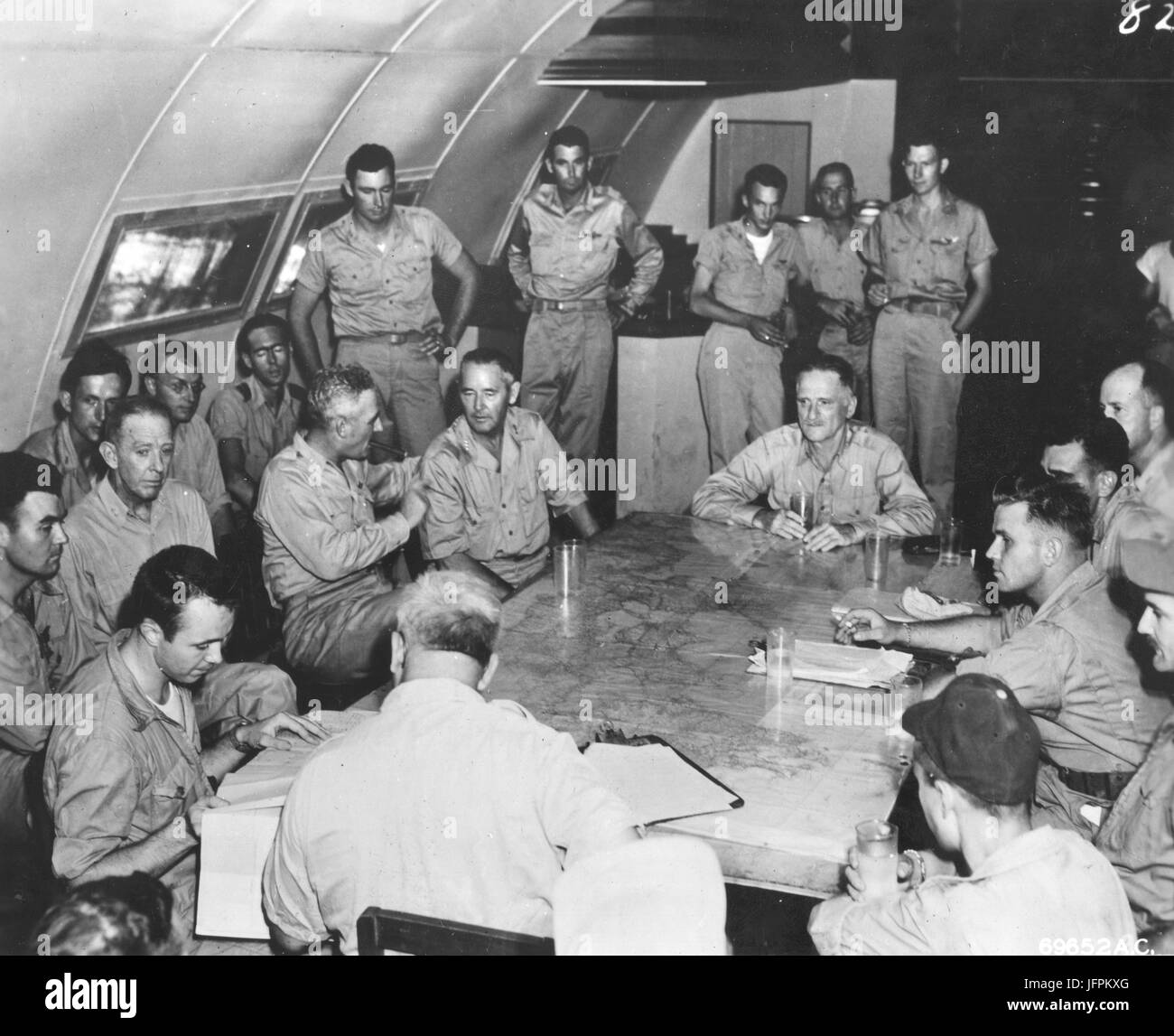 Lt. General Nathan Twining, Lt. General Barney M. Giles and General Carl Spaatz (left to right around table) attend - Stock Image