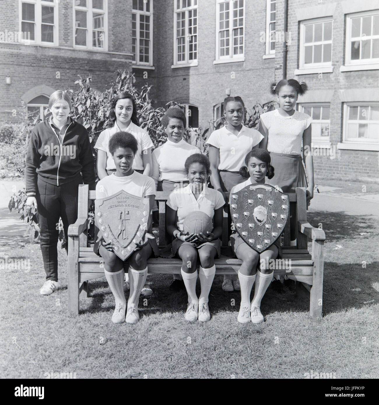 A netball team in the London Senior Netball League during the 1970s. Team comprises of mainly black, afro-caribbean - Stock Image