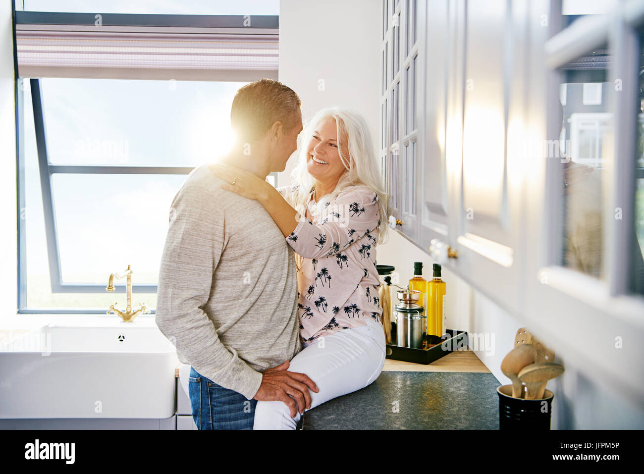 Smiling senior woman sharing a romantic moment with her husband ...