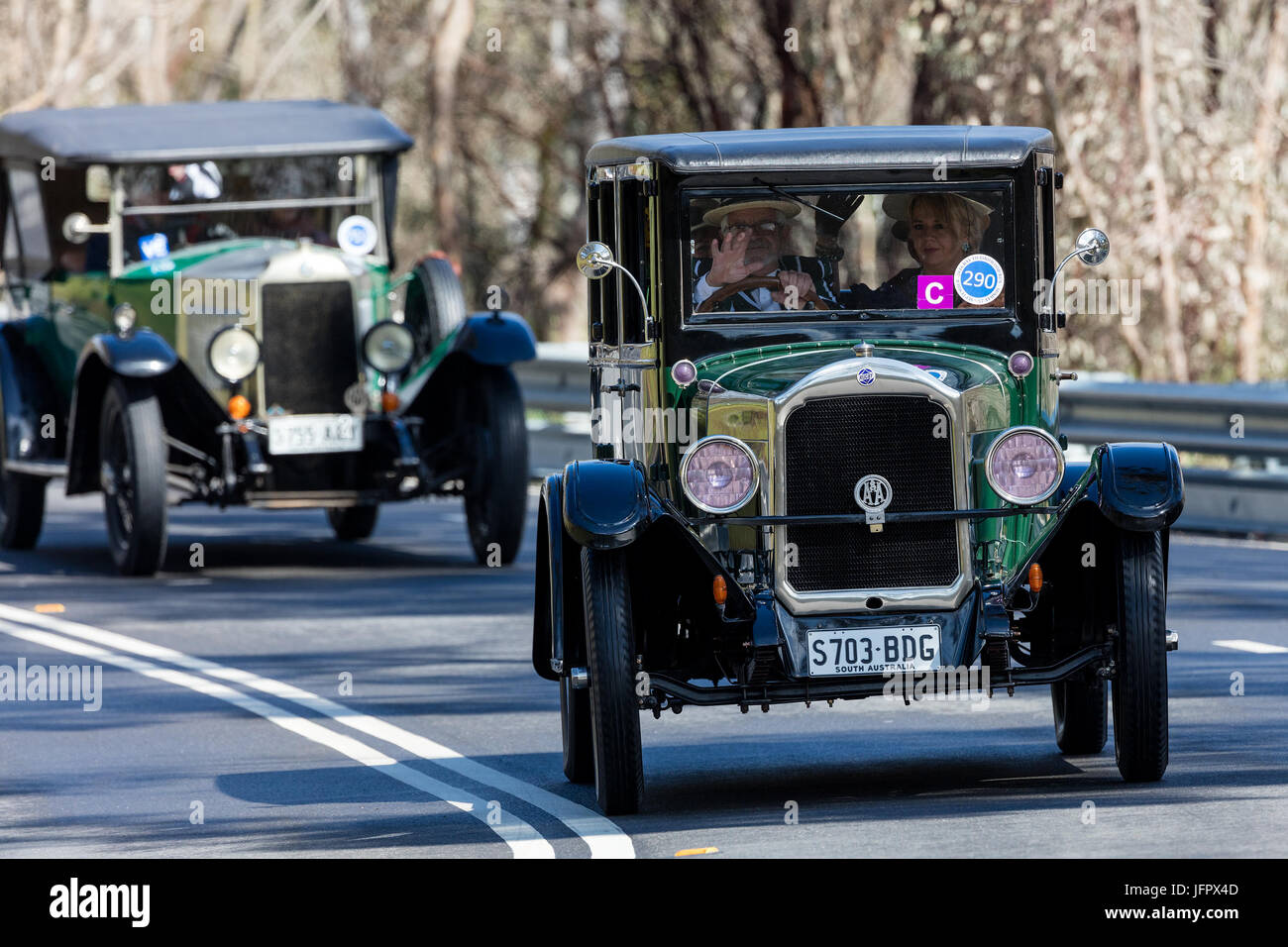 Vintage 1926 Rugby R Sedan driving on country roads near the town of Birdwood, South Australia. - Stock Image