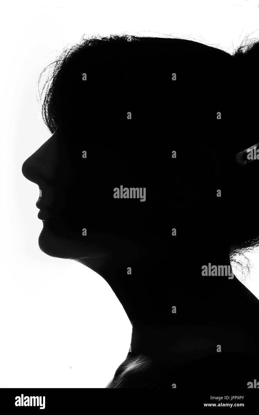 Black and white female silhouette simply created by standing in front of a softbox - Stock Image